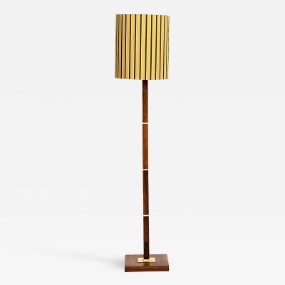 Fog M rup A DANISH MID CENTURY FOG M RUP ROSEWOOD AND BRASS FLOOR LAMP