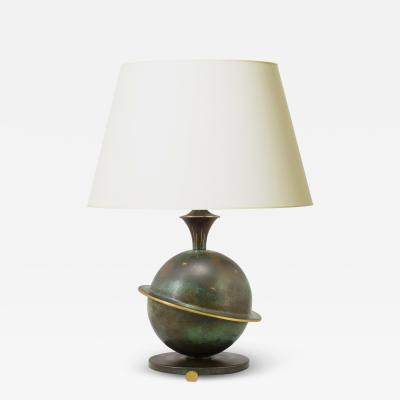 GAB Guldsmedsaktiebolaget Table lamp with Saturn theme in patinated brass attributed to GAB