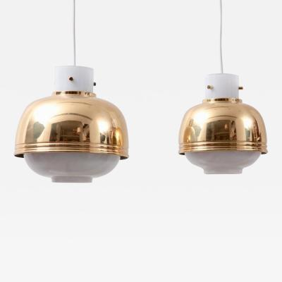 Glash tte Limburg Pair of Brass and Glass Pendant Lamp by Glash tte Limburg
