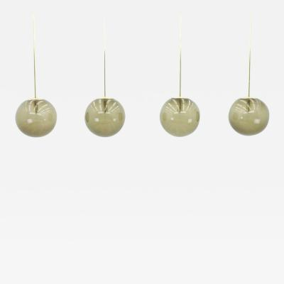 Glash tte Limburg Set of Four Large Smoked Glass Ball Lamps with Extra Length Brass Rod by Limburg