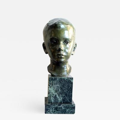 Gorham Manufacturing Co An American 1940s bronze bust of a young boy signed J G Kendall