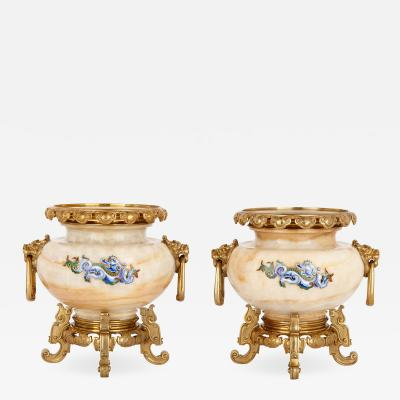 H Journet Cie Two gilt bronze mounted enamelled onyx urns by H Journet Cie