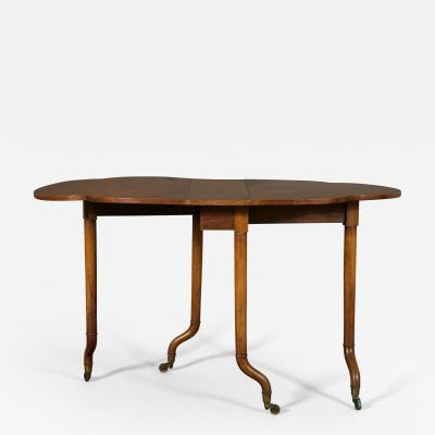 Holland Sons An Unususal Walnut Gateleg Table by Holland Sons