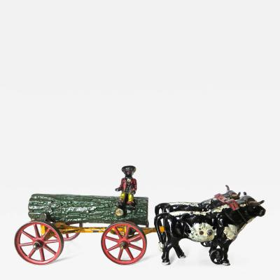 Hubley American Cast Iron Toy Oxen Drawn Log on Carriage with Rider Hubley Ca 1906