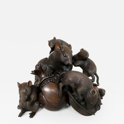 Itsumin An antique Bronze Okimono of a family of rats devouring a pomegranate