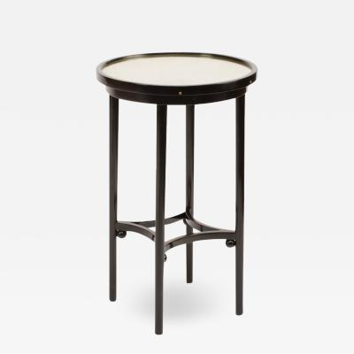 J J Kohn A small Austrian side table executed by J J Kohn design attributed to J Hoffman