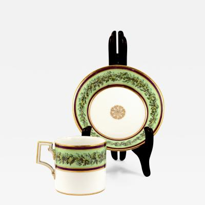 Konigliche Porzellan Manufaktur KPM KPM EMPIRE PORCELAIN CUP AND SAUCER DECORATED WITH A GREEN FLOWER BORDER