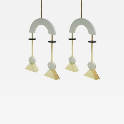 L A Studio L A Studio Pair Of White Lacquered Wood And Bronze Pendant Lamp United Kingdom