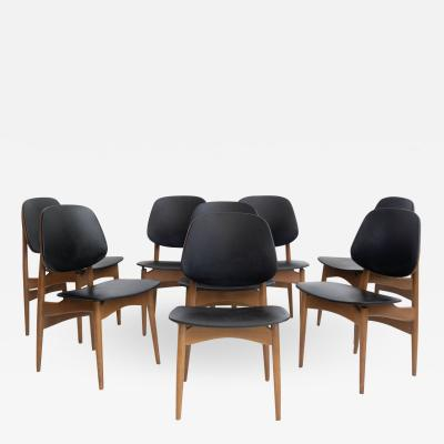 La Permanente Mobili Cant Set of Eight Black Faux Leather and Wood Dining Chairs