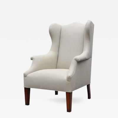 Lee Stanton Editions A Tall Wing Chair with Tapered Legs Upholstered in Belgium Linen or Com