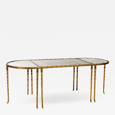 Maison Bagu s Gilt bronze eglomized glass top cocktail table by Maison Bagues