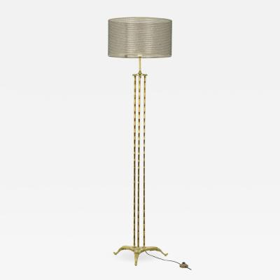 Maison Bagu s Maison Bagu s Tripod floor lamp in gilt bronze 1970s