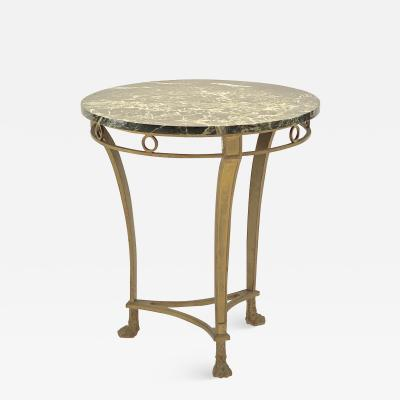 Maison Bagu s Maison Bagues early coffee table in gold leaf wrought iron