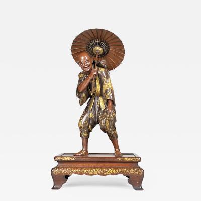 Miyao A large Japanese 19th Century Bronze Okimono of a monkey trainer Miyao