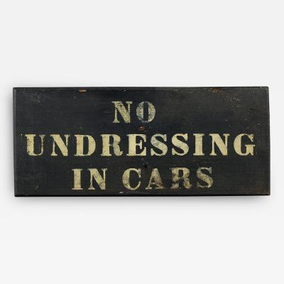 NO UNDRESSING IN CARS SIGN