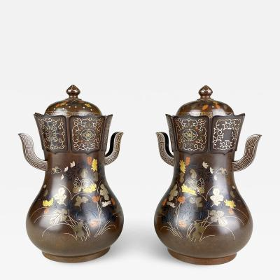 Nogawa A pair of decorative Bronze and multi metal covered vases by Nogawa