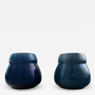 R rstrand A pair of Art deco lidded vases in dark blue faience