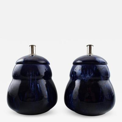R rstrand A pair of lidded vases in dark blue faience