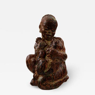 Royal Copenhagen Royal Copenhagen Stoneware Figure of black boy with cat 20244