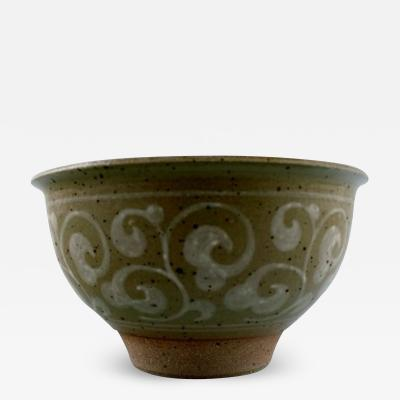 Royal Copenhagen Stoneware bowl decorated with bright spiral pattern on green background