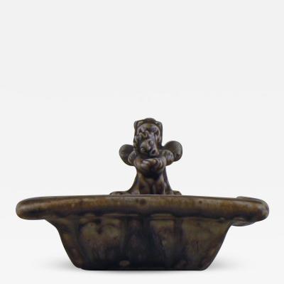 Royal Copenhagen Stoneware dish modeled with mythical creatures
