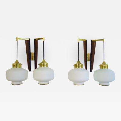 Stilnovo A pair of STILNOVO modernist wall lamps in teak and brass