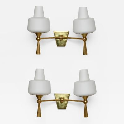 Stilnovo Pair of wall lamps in the style of Maison Lunel