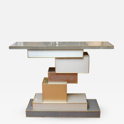 Studio Glustin Side table in brass and mirror