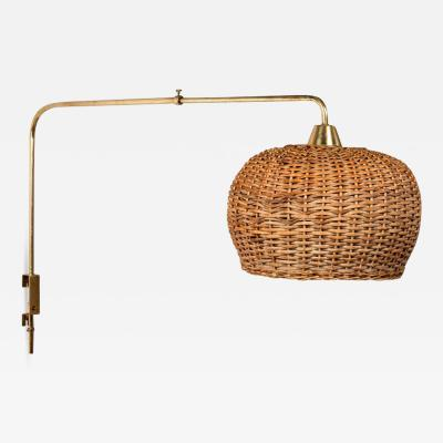 Taito Oy Rare 1950s Paavo Tynell Articulating Brass and Wicker Wall Light for Taito Oy