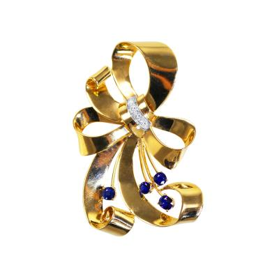 Tiffany Co Retro 14 Karat Gold Platinum Sapphire and Diamond Brooch by Tiffany Co