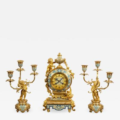 Tiffany and Co A French Gilt Bronze and Champleve Enamel Clock Set Retailed by Tiffany Co
