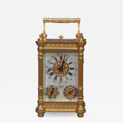 Tiffany and Co c 1900 French Gilt Bronze Carriage Clock with Calendar Dials