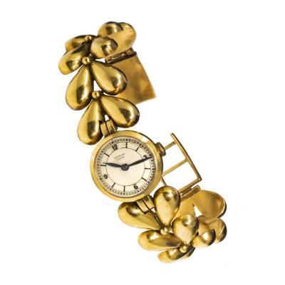 Universal Gen ve 1950s Universal Flower Petal Motif 18 Karat Yellow Gold Bracelet Wristwatch