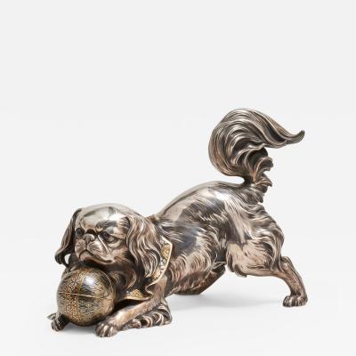 Unno Shomin A Japanese silver Okimono of a dog