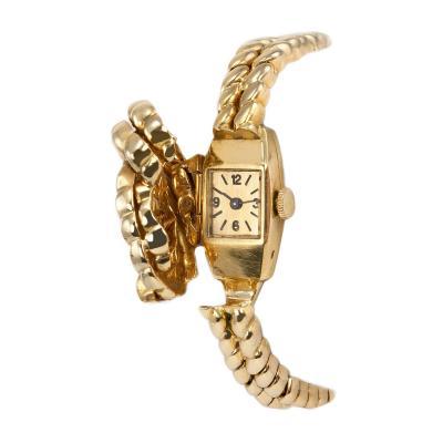 Van Cleef Arpels Van Cleef Arpels Hidden Watch Gold Knot Bracelet Circa 1960s