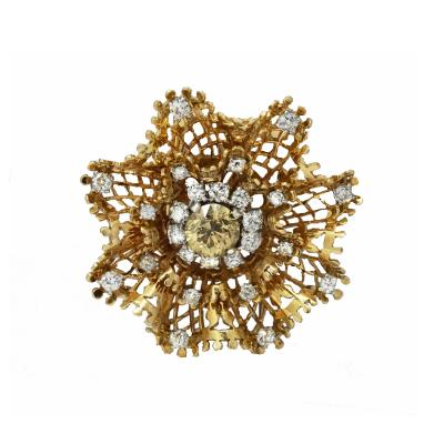 Van Cleef and Arpels Classic Van Cleef Arpels Flower Brooch set with a fancy colored diamond