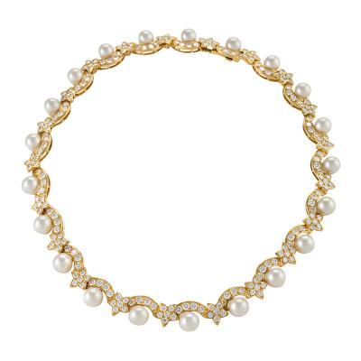 Van Cleef and Arpels Van Cleef Arpels Diamond Pearl and Gold Star Necklace
