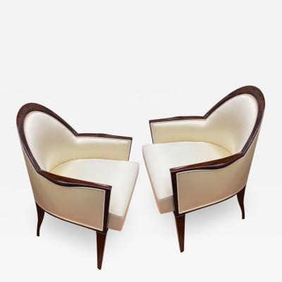 mile Jacques Ruhlmann J E Ruhlmann pair of refined solid Makassar arm chairs covered in satin silk