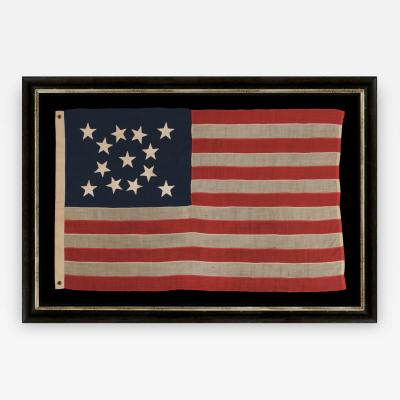 13 Hand Sewn Stars In A Beautiful Medallion Configuration on an Antique Flag