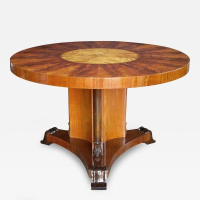 A finely crafted Swedish art deco mahogany and birch wood circular table