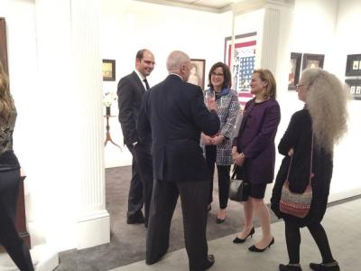 MFA Boston curators at the booth of Frank & Barbara Pollack