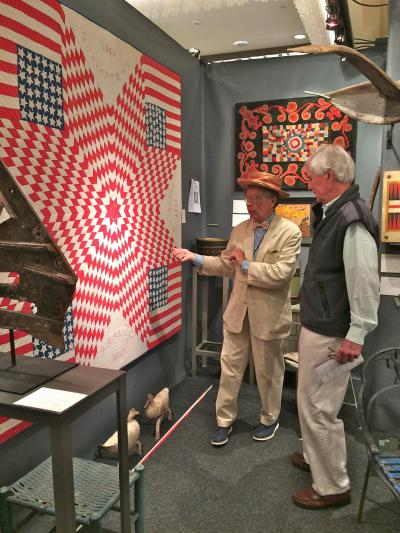 Stephen Score discusses a quilt with collector Amos Hostetter.