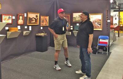 Don Olson Fin American Antiques, Booth 44. Don speaking with Stephen Weiss.
