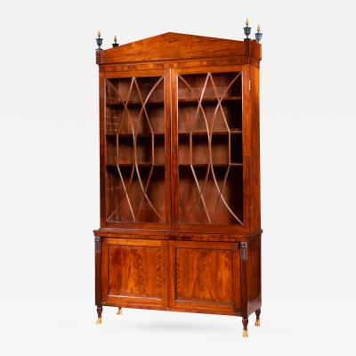 Extremely Fine and Rare Federal Carved Mahogany Bookcase with Brass Paw Feet