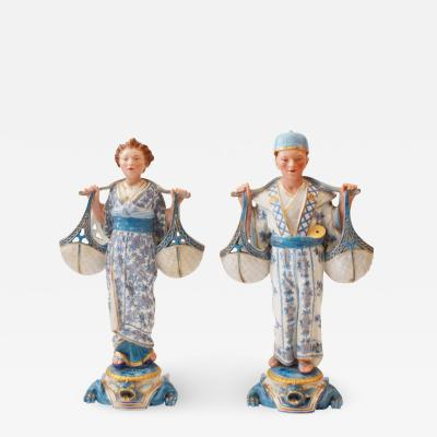 A Fine Pair of German KPM Chinese Figures