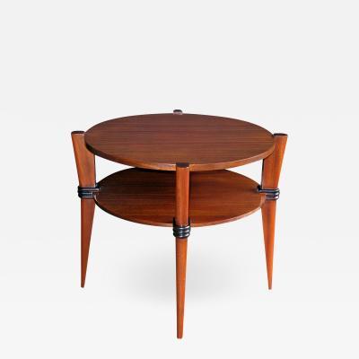 A Chic French Ribbon Mahogany Circular Side Table with Ebonized Highlights