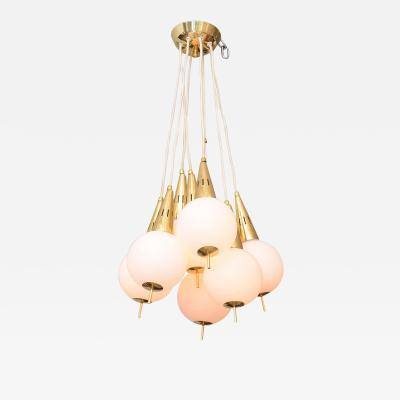 Italian Modern Brass and Glass Eight Light Chandelier in the Manner of Stilnovo