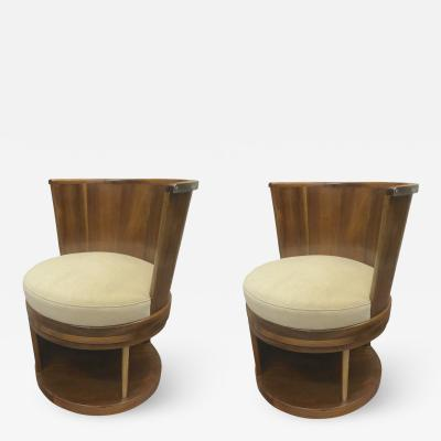 Pair of stunning French modernist barrel swivel arm chairs