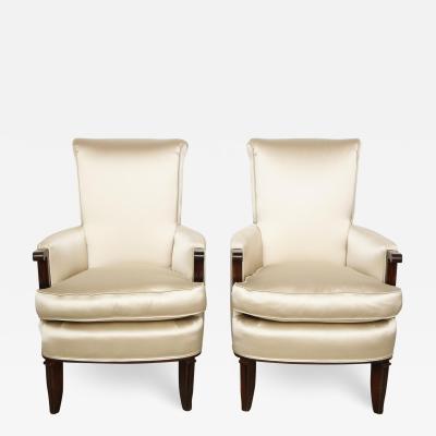 Jules Leleu Elegant pair of satin and walnut armchairs by Jules Leleu