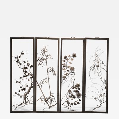 Set of four Japanese iron wall panels